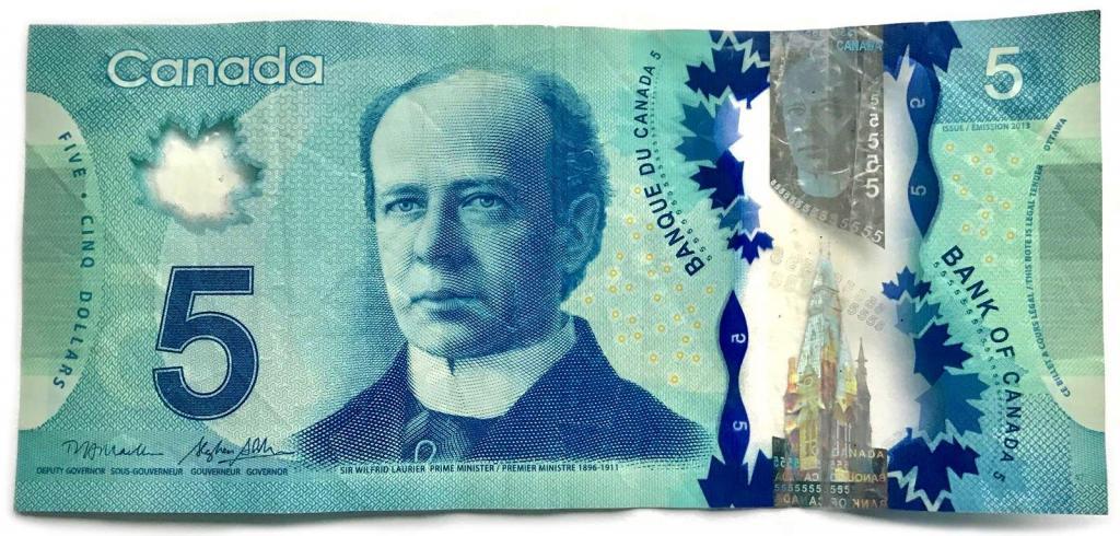 Канадский доллар фото