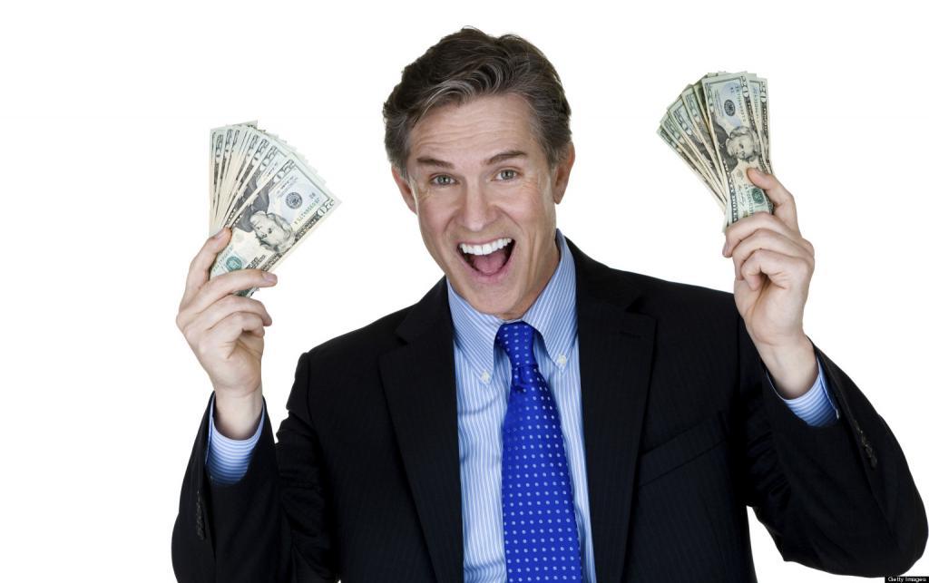 Доллары в руках у бизнесмена.