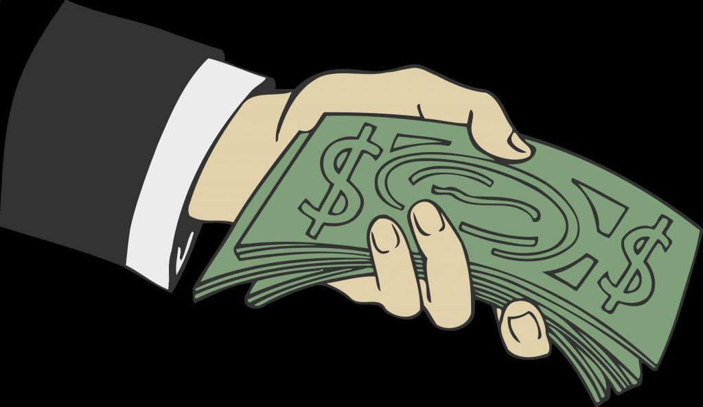 Рука держит деньги.